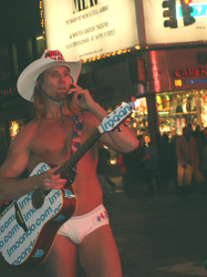 Naked_cowboy_on_the_phone_shawn
